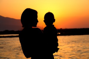 """<img src=""""mother at ocean with baby"""" alt=""""mother holding baby at ocean at sunset"""">"""
