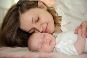 "<img src=""smiling mother with sleeping baby"" alt=""smiling mother face to face with sleeping baby"">"